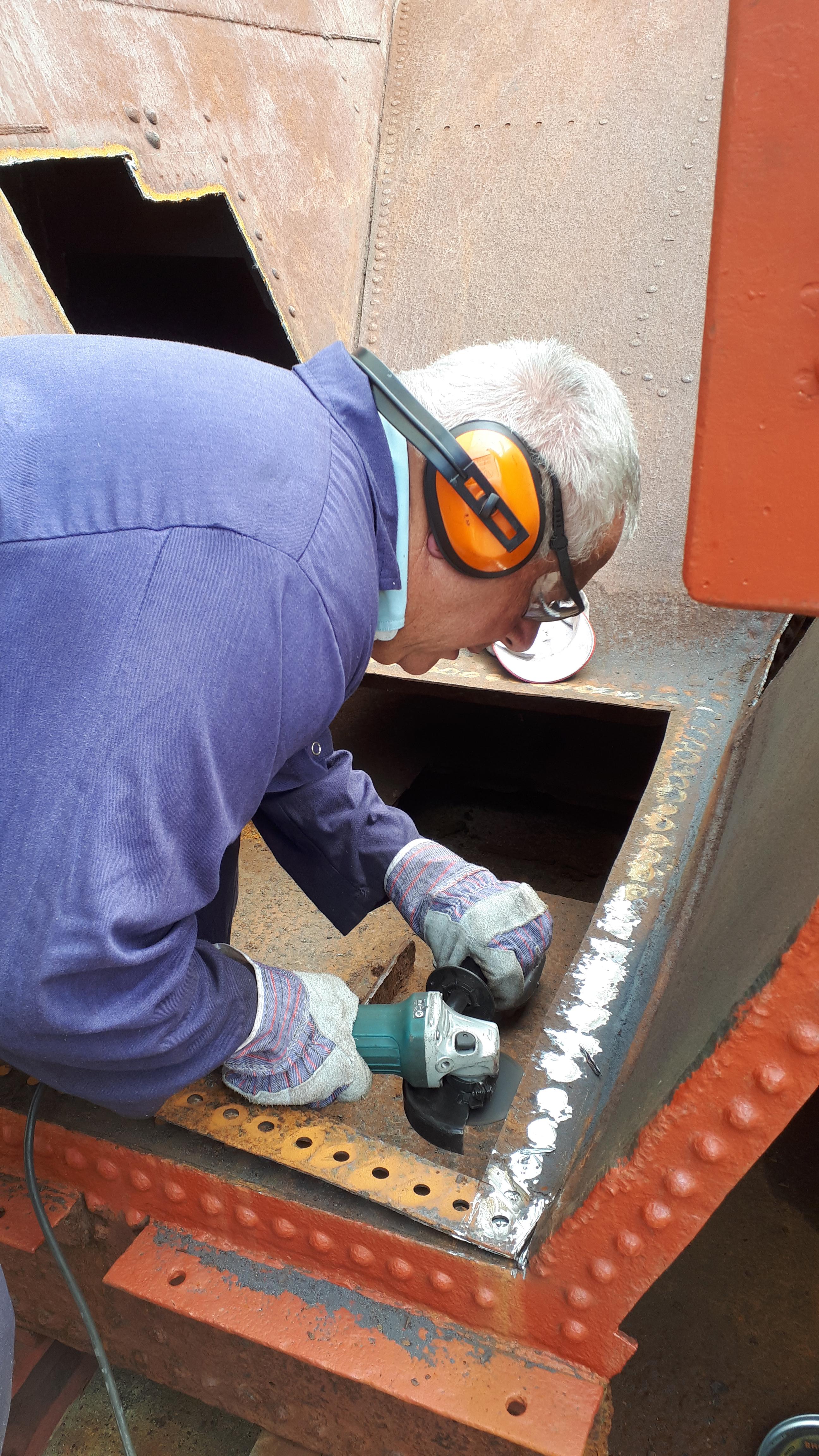 John Davis removes rivets from Wootton Hall's tender tank.