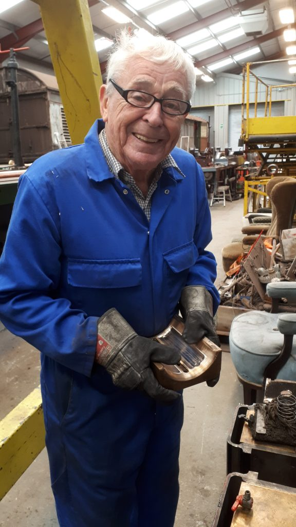 Bill Norcross with one of the machined bearings