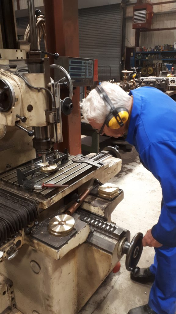 Bill Norcross preparing to drill holes in a brass flange for Wootton Hall