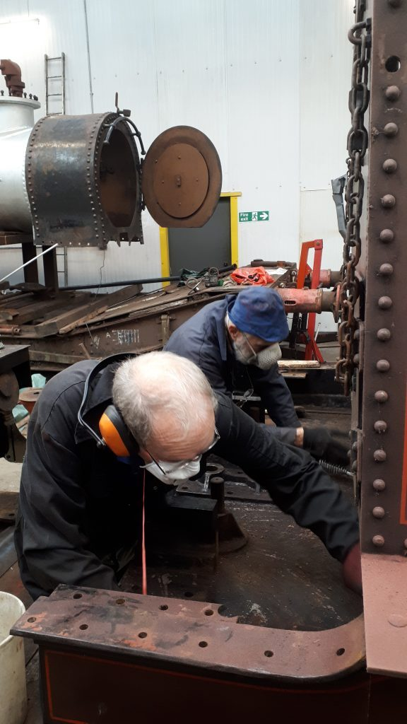 John Dixon and Roger cleaning the front drag box on FR 20's tender