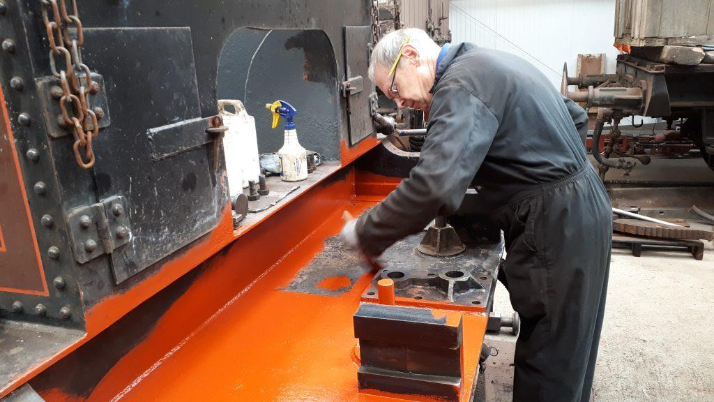 John Dixon applies a coat of primer to FR 20's front tender drag box