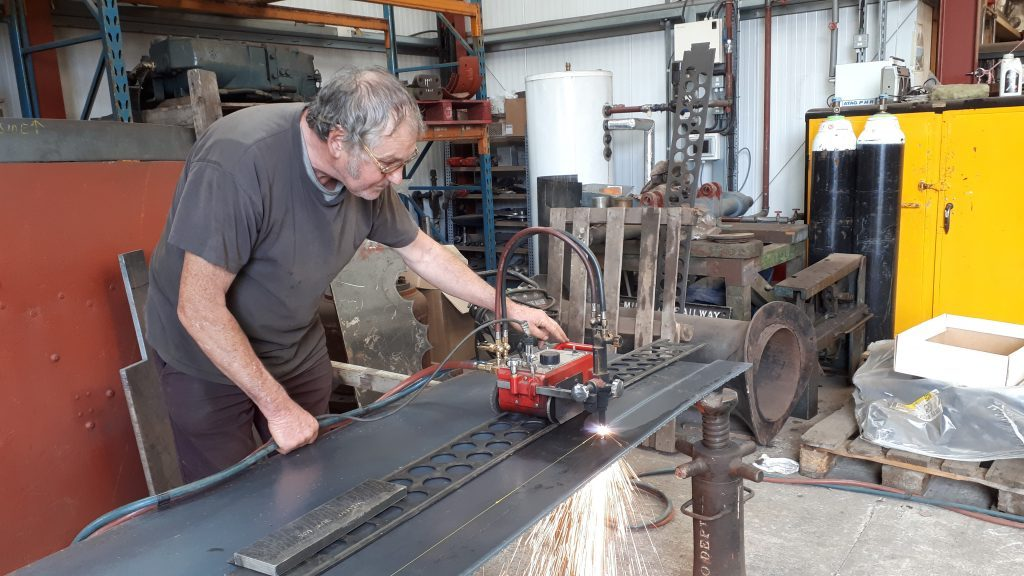 Keith cutting new steel plate for Fluff's running board