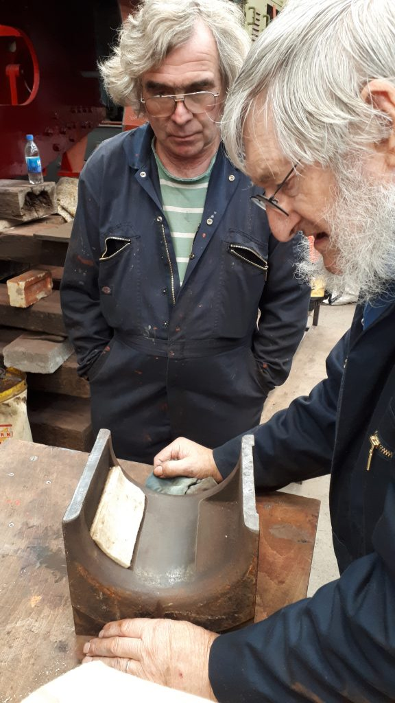 Alan and Adrian with a new felt pad in one of Caliban's axleboxes