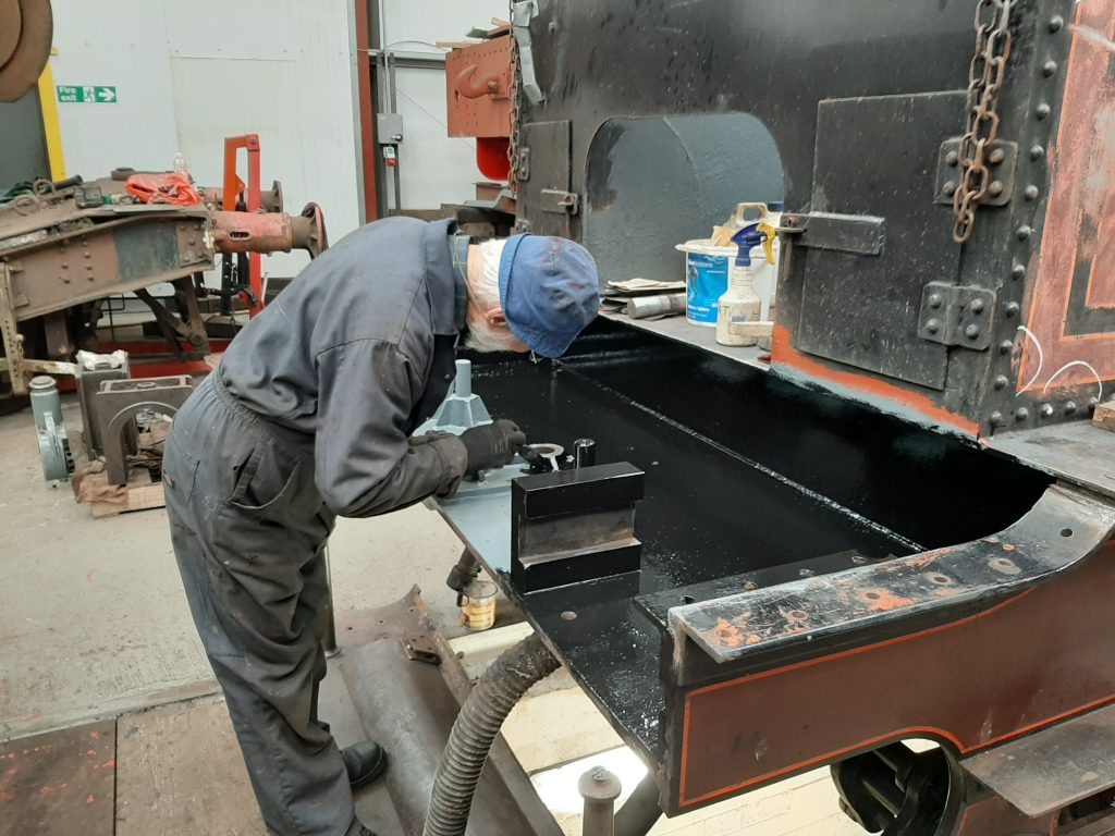 Roger painting the interior of FR 20's front tender drag box
