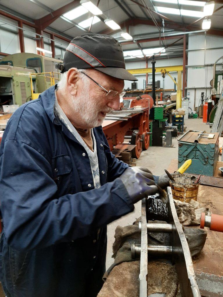 Phil Bell cleaning one of FR 20's tender brake hangers