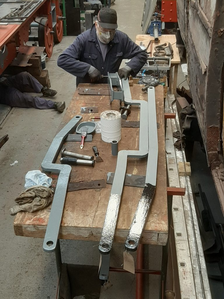Phil Bell with a selection of FR 20's brake rigging for painting