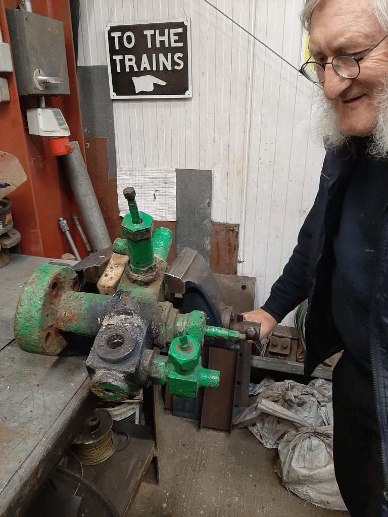 Alan sizes up the replacement manifold for Caliban
