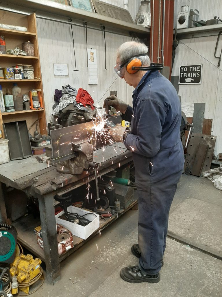 John Dixon making the sparks fly whilst making a modification to FR 20's tender drawgear