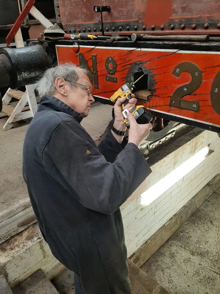 John Dixon repairing FR 20's tender drawgear
