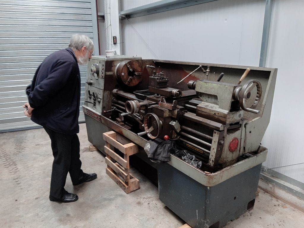 Alan inspecting the new lathe