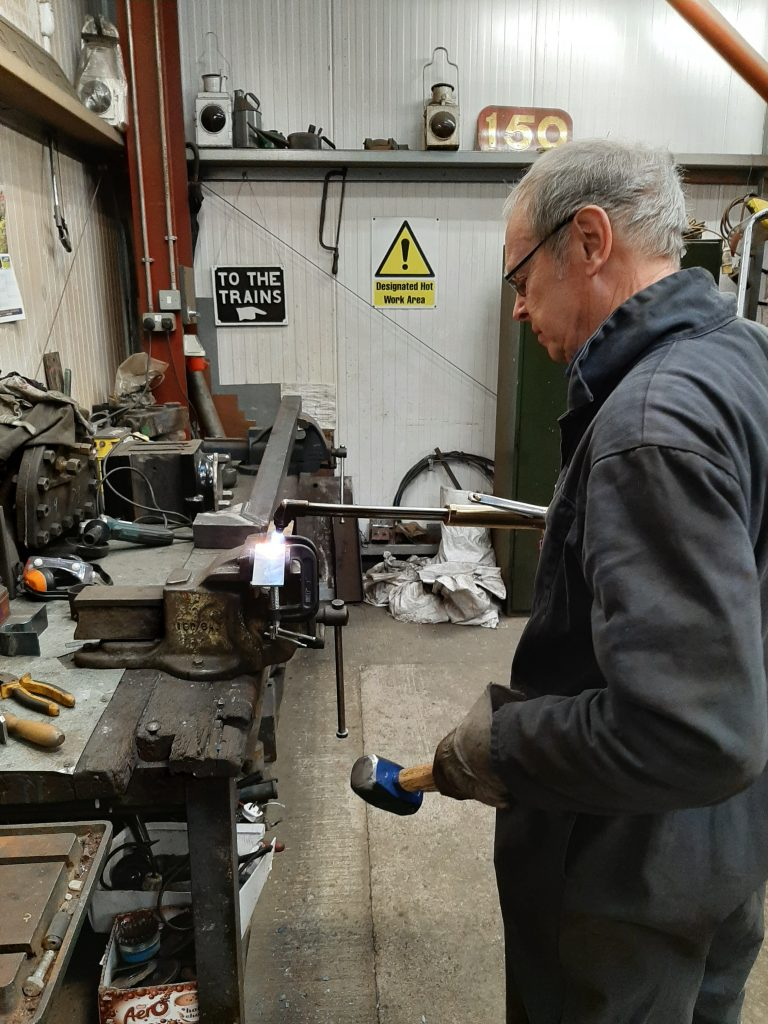 John Dixon then shapes the steel into a new bracket