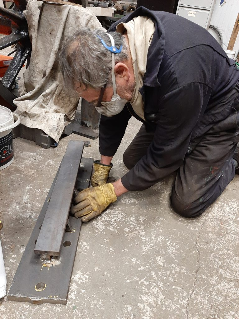 Keith preparing the base plate for Wootton Hall's screw reverser for welding