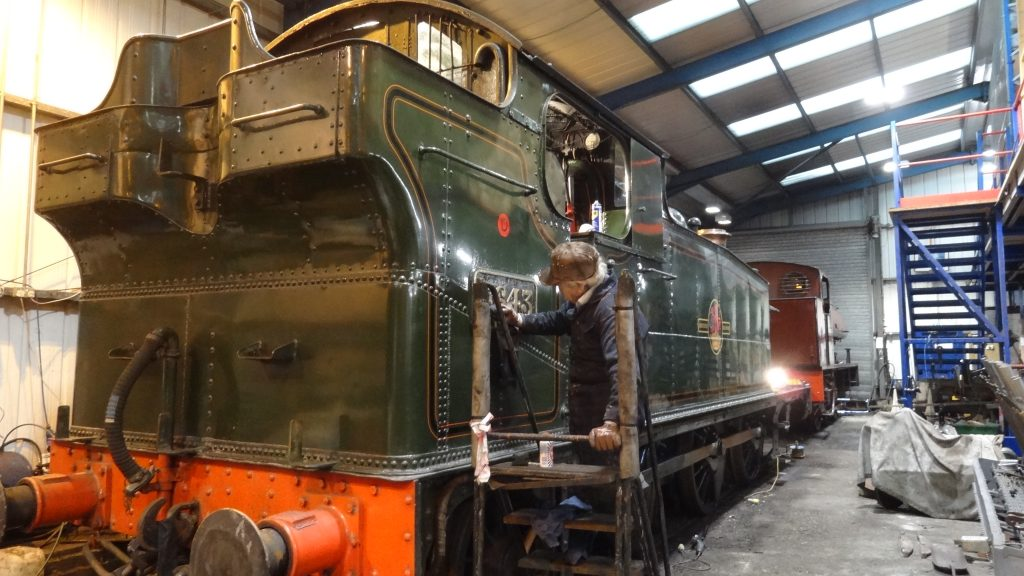 Fred cleans one of 5643's brass number plates