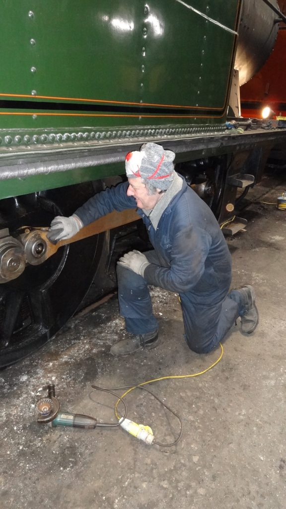 Mike Rigg polishes the coupling rods