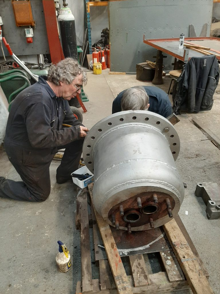Ade and Alan in the process of removing the valve seats from FR 20's dome