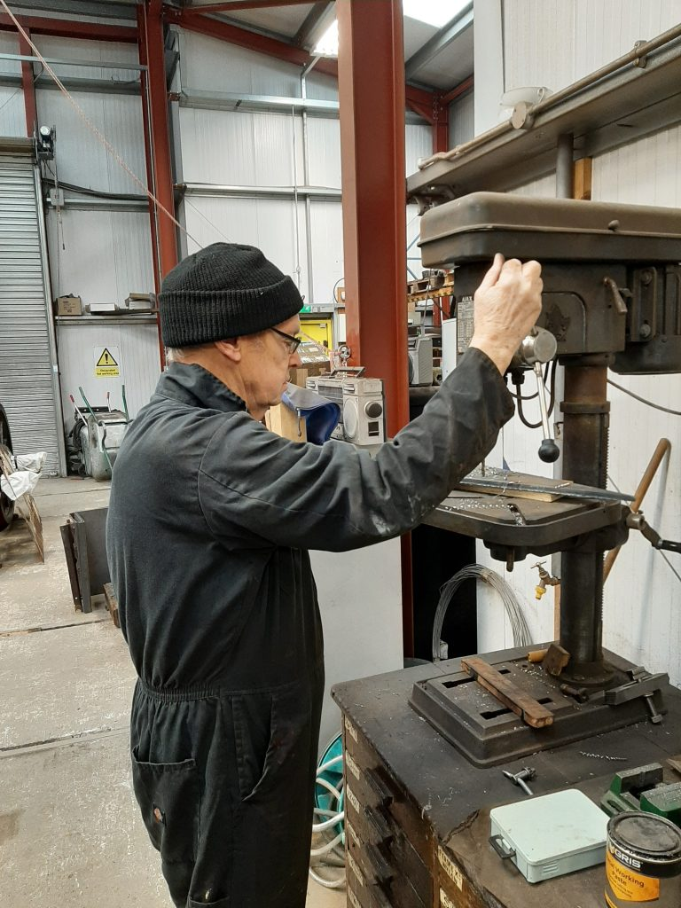 John Dixon drills some holes in a blank for FR 20's boiler