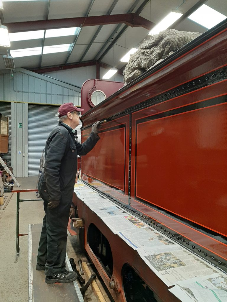 John Dixon checks for rivet head dribbles of varnish