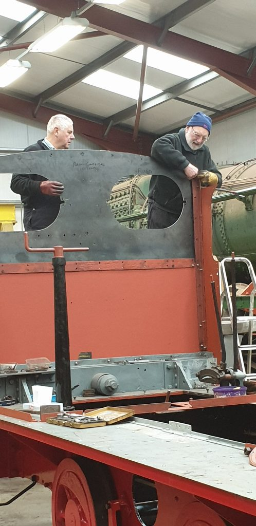 John Davis and Phil building Fluff's cab