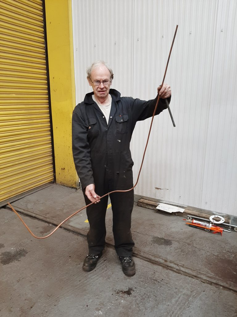 John Dixon with refurbed brake pipe for FR 20's tender