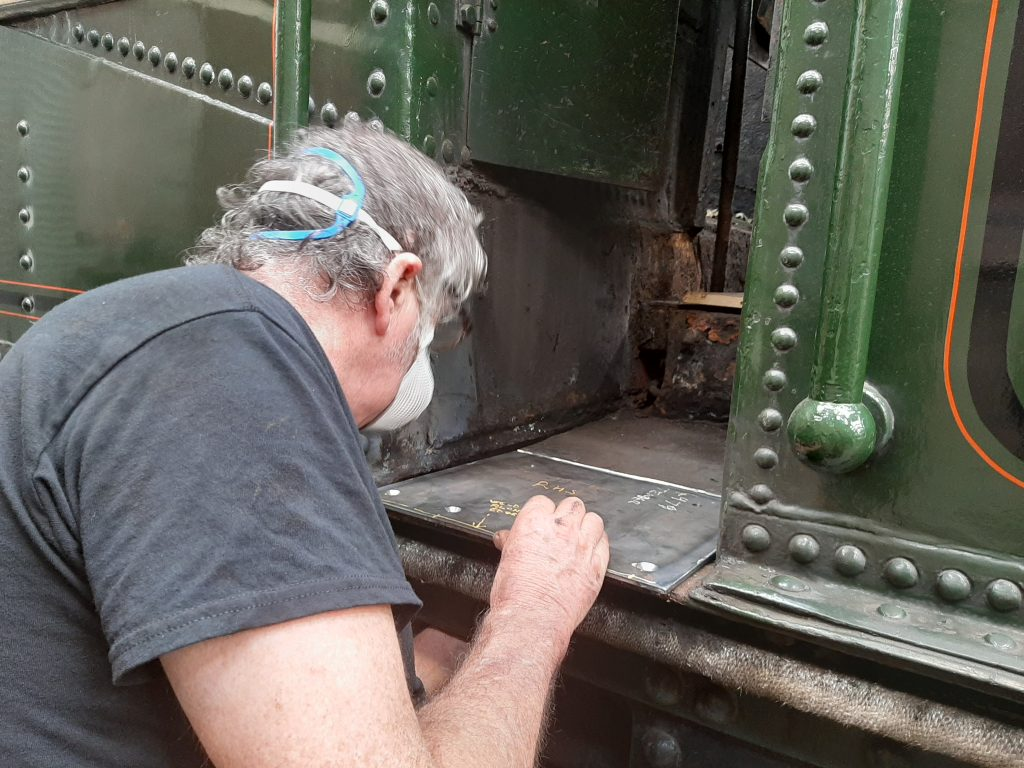 Keith making a new cab step plate for 5643