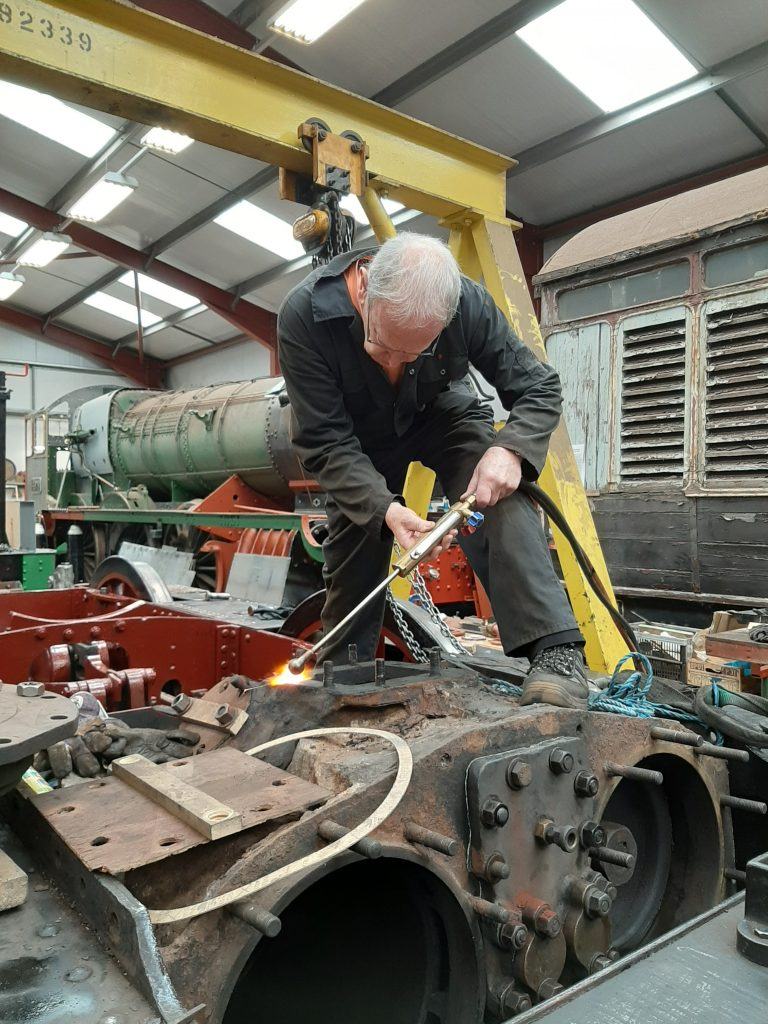 John Dixon applying heat to one of FR 20's blast pipe studs