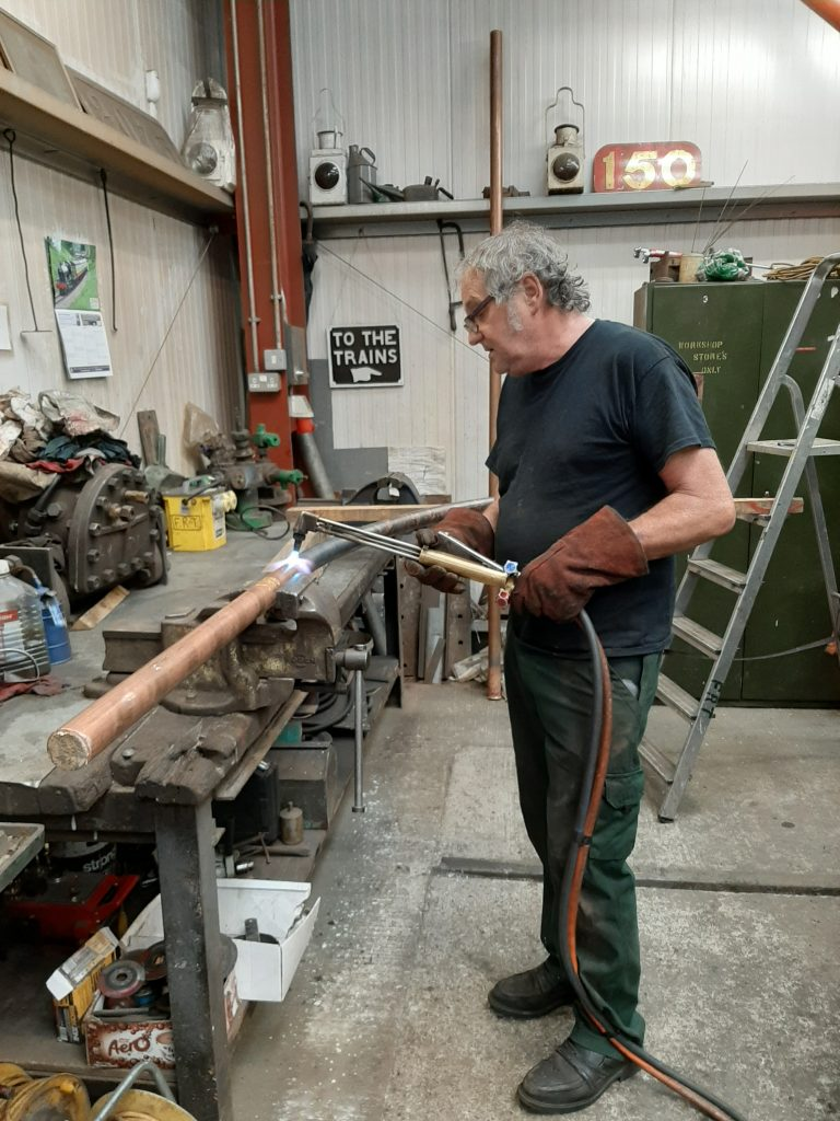 Keith shaping one of Wootton Hall's injector delivery pipes