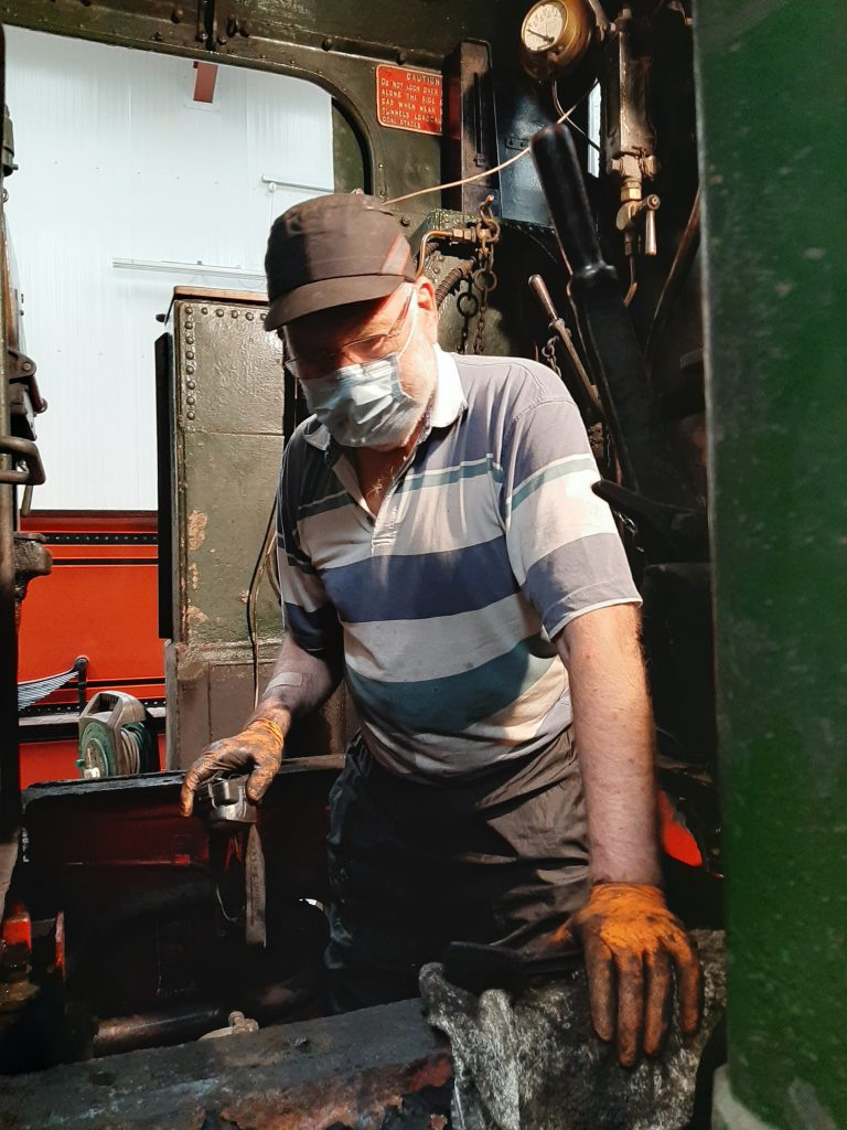 Phil Bell cleaning below 5643's cab floor