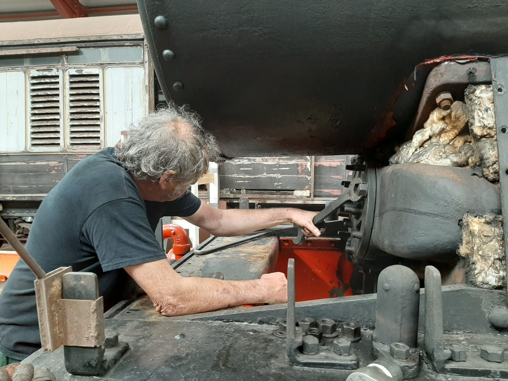 Keith removes a valve cover on 5643