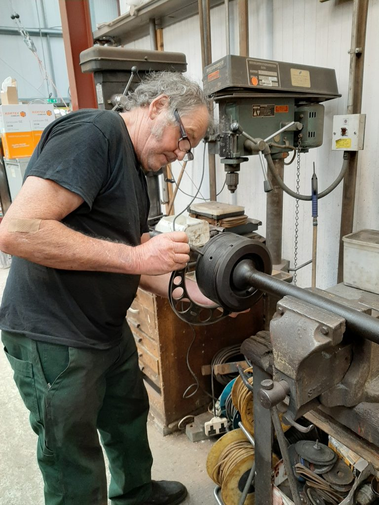 Keith measures one of 5643's valves