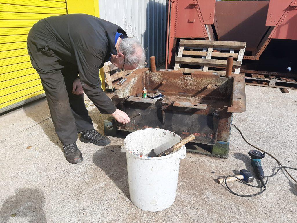 John Dixon cleaning up FR 20's ashpan
