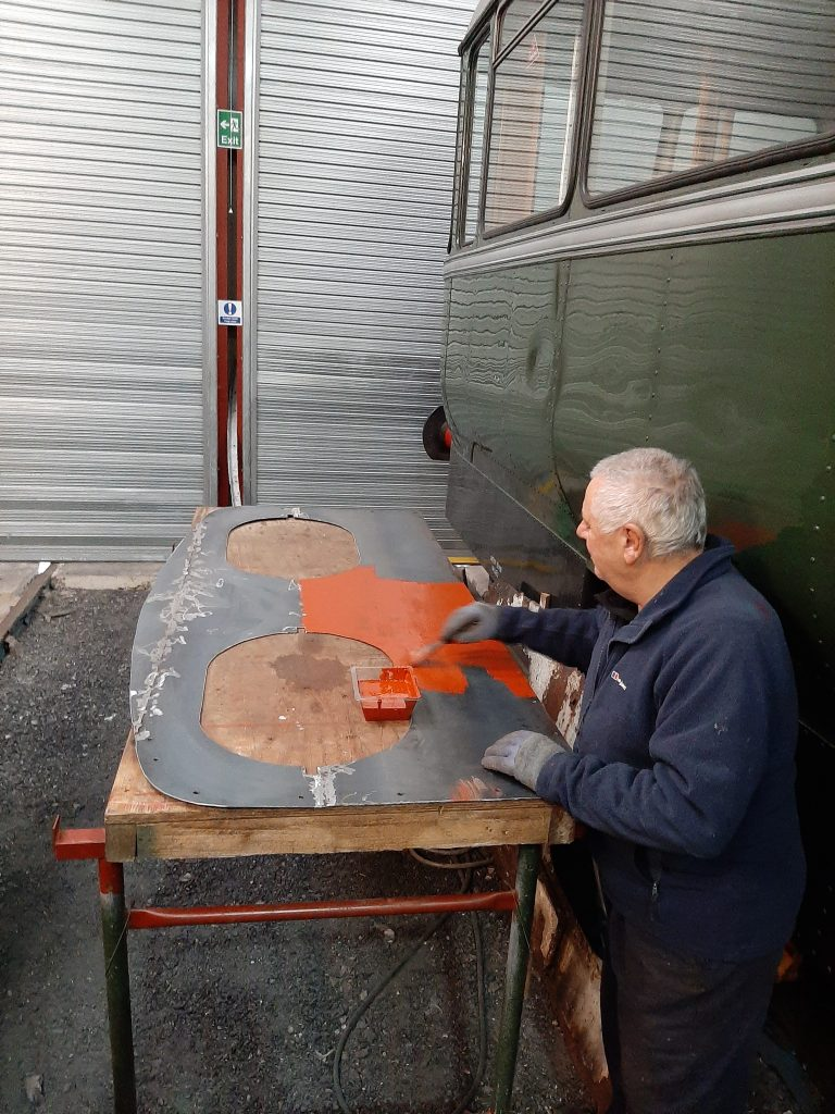 John Davis painting Fluff's cab spectacle plate