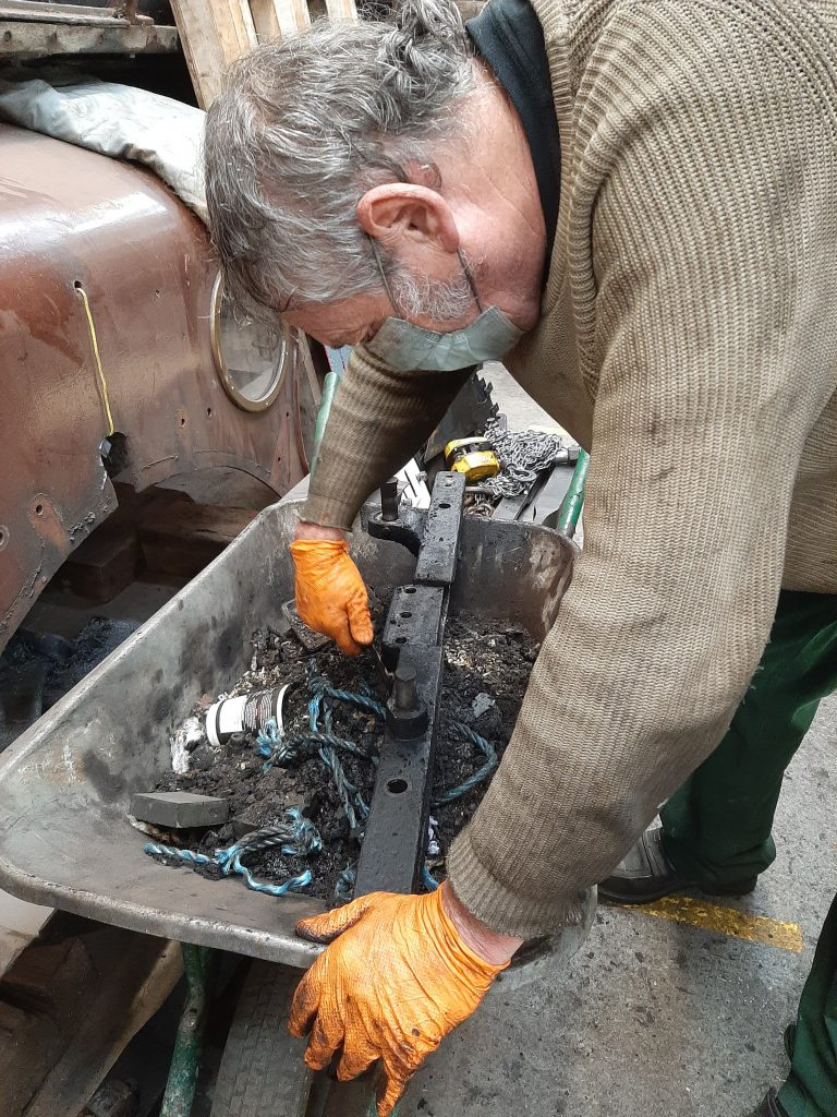 Keith cleaning the firehole door support for 5643