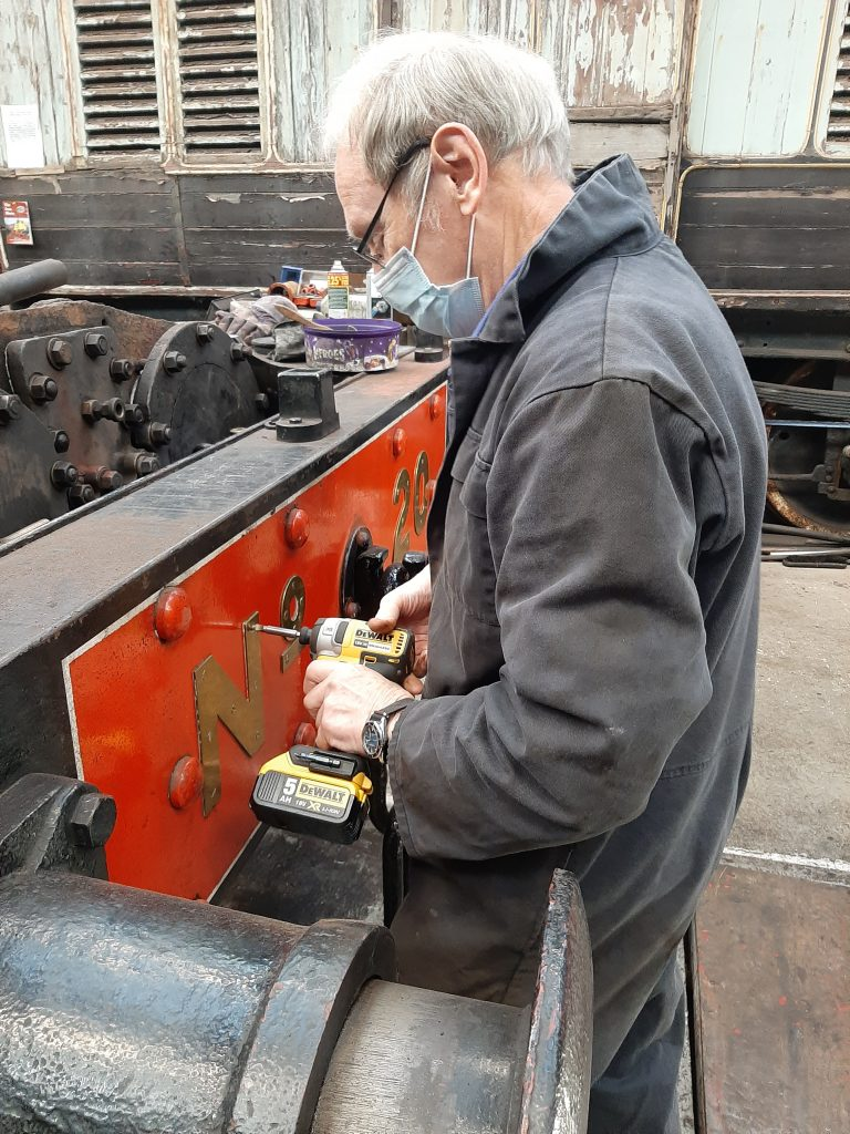 John Dixon removing the screws holding the numbers on FR 20's buffer beam