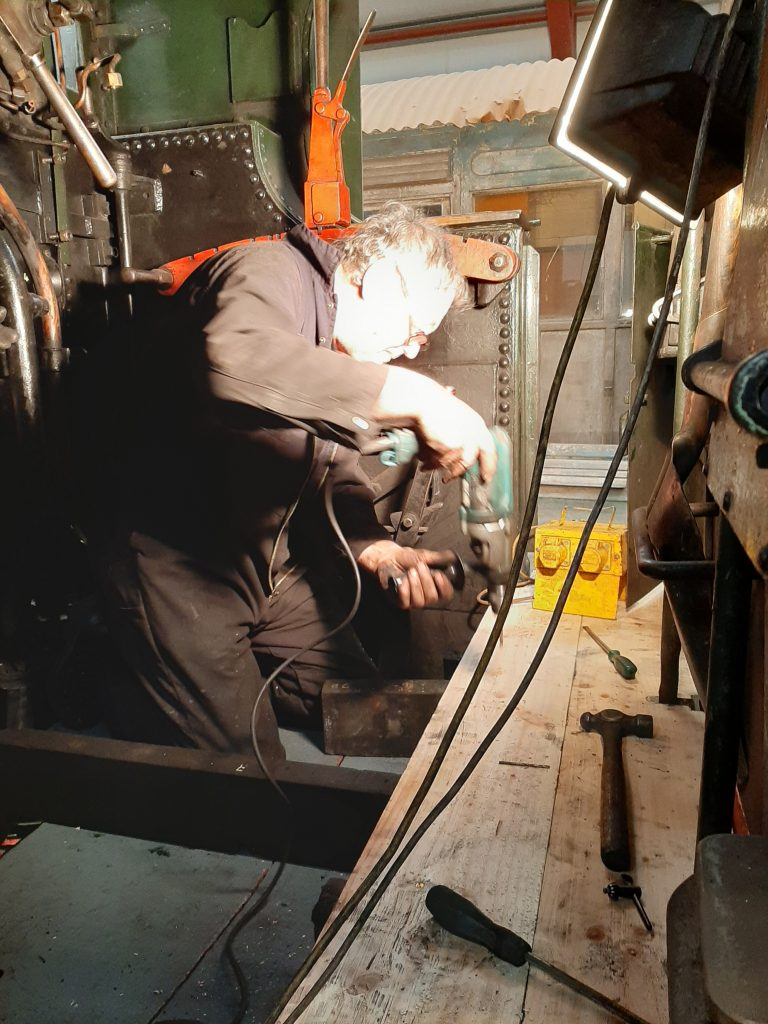 Keith fitting the new cab floor in 5643