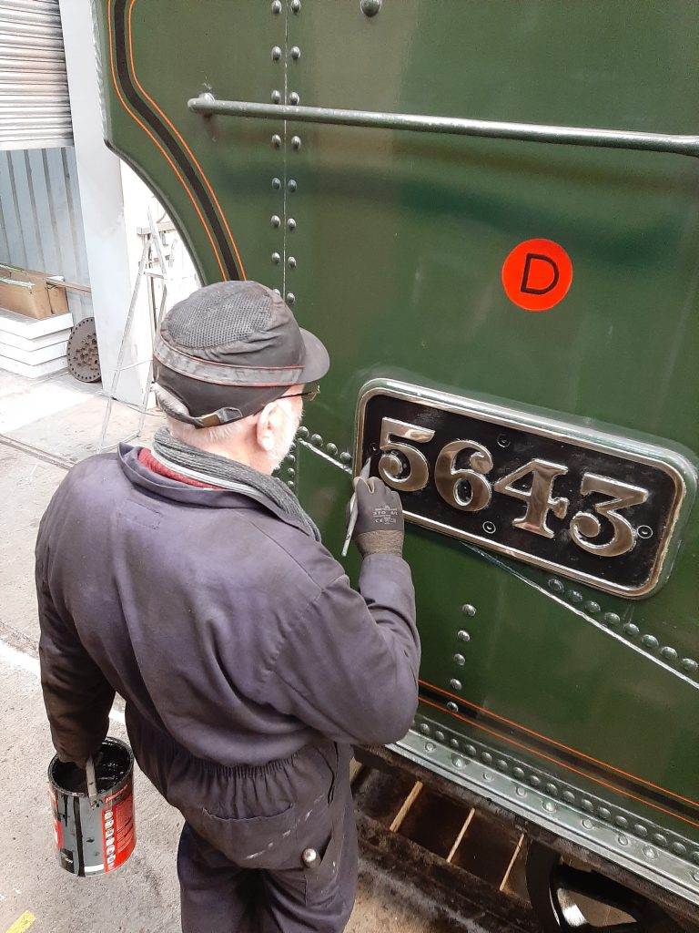 Phil touches up the black paintwork on 5643's brass numberplates