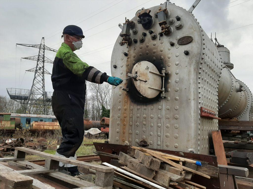 Alan Bennett inspects the firebox on FR 20's boiler