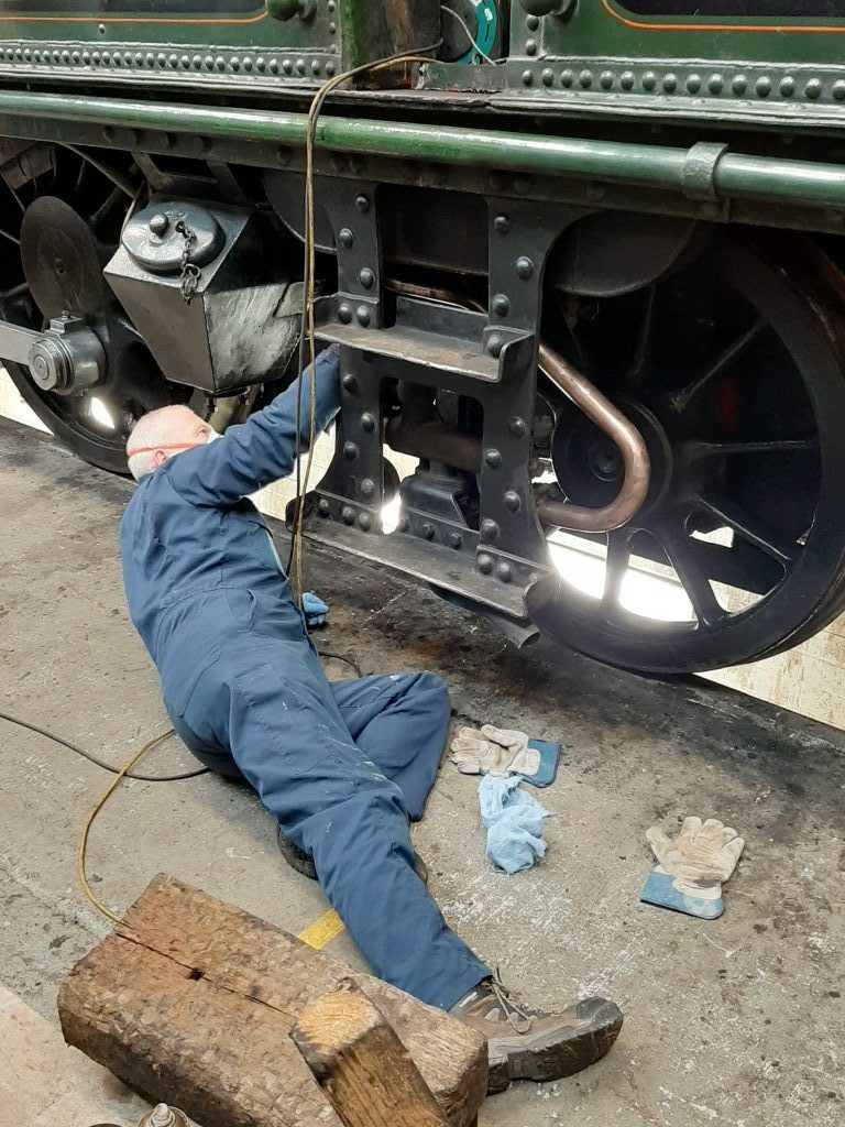Paul Newton cleans some of 5643's copper pipework