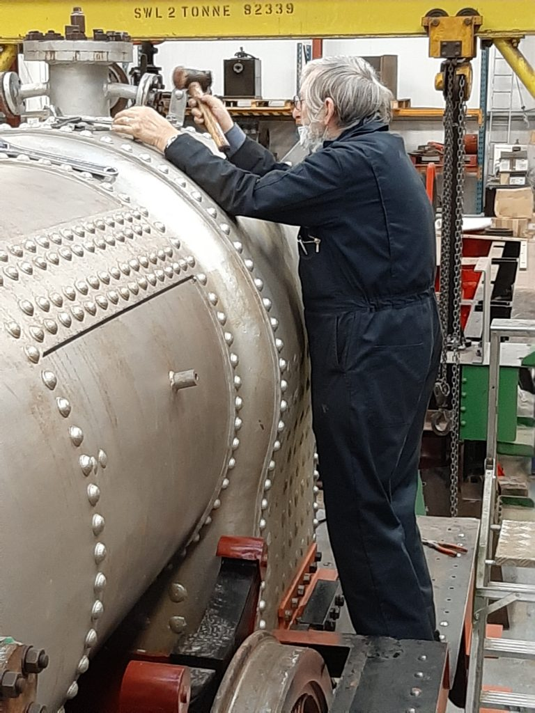 Alan Middleton removing blanks from the boiler