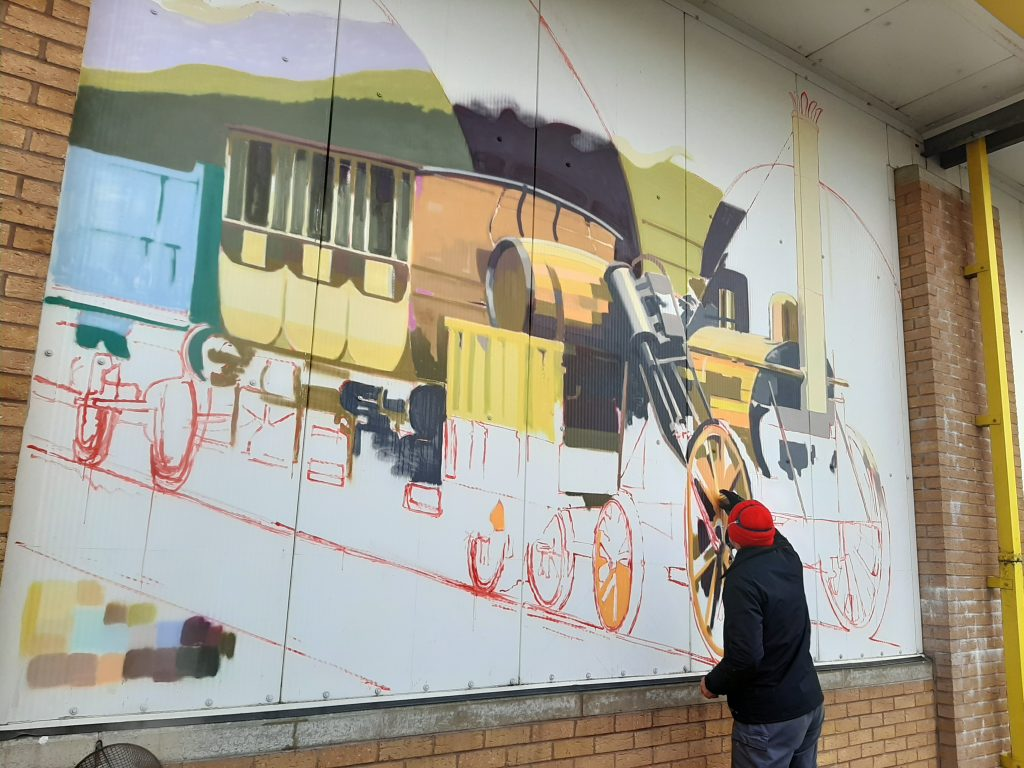 Gavin Renshaw working on the first of the RSR's timeline murals