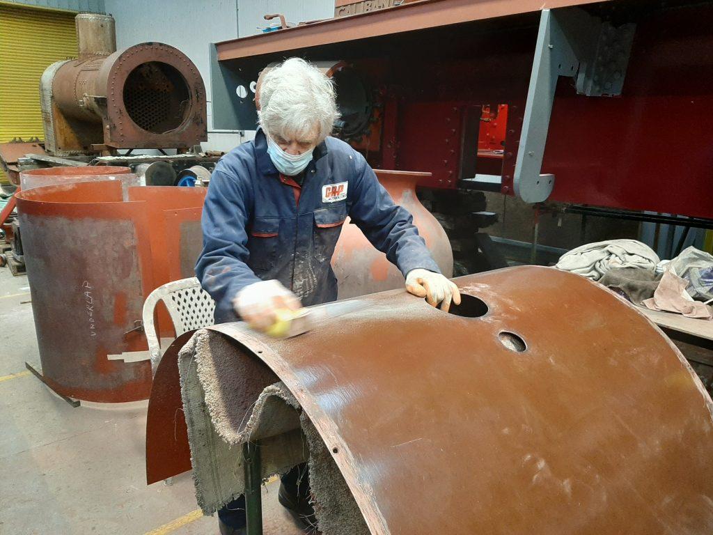 Ed Tatham sanding FR 20's boiler cladding