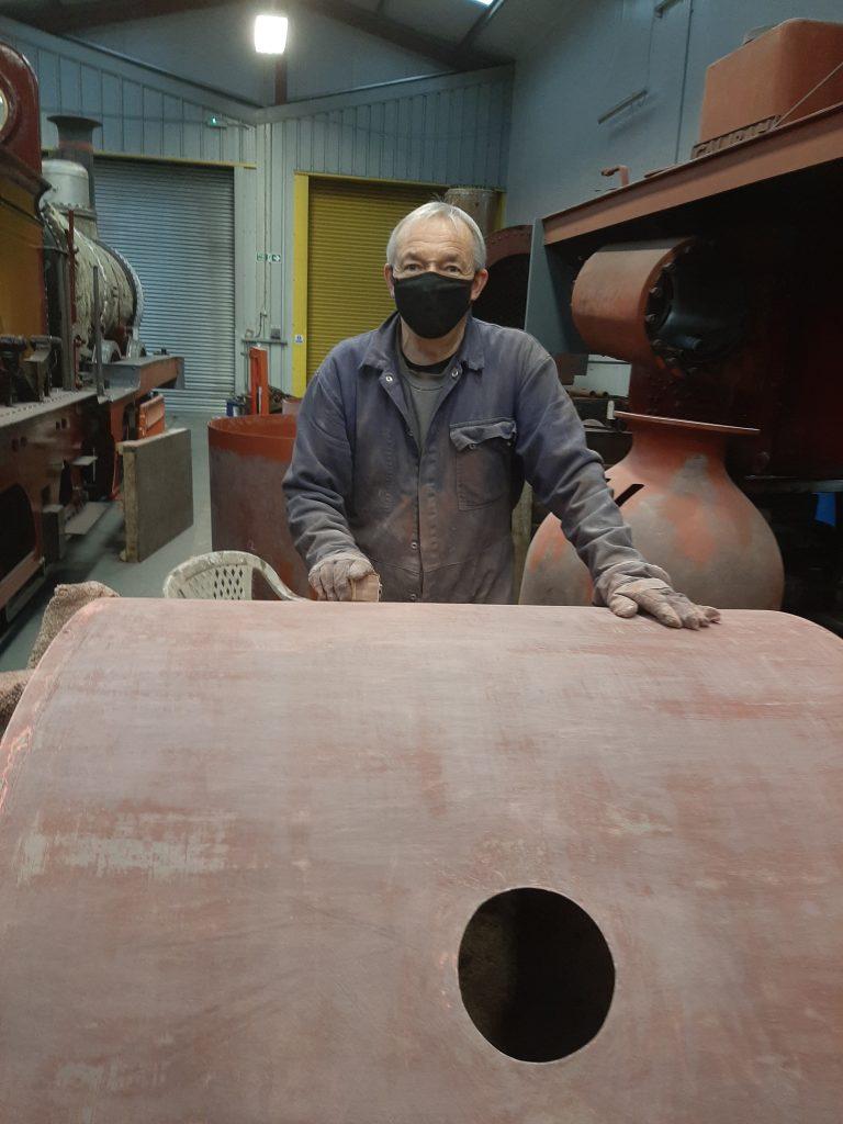 Tim Owen at work on FR 20's boiler cladding
