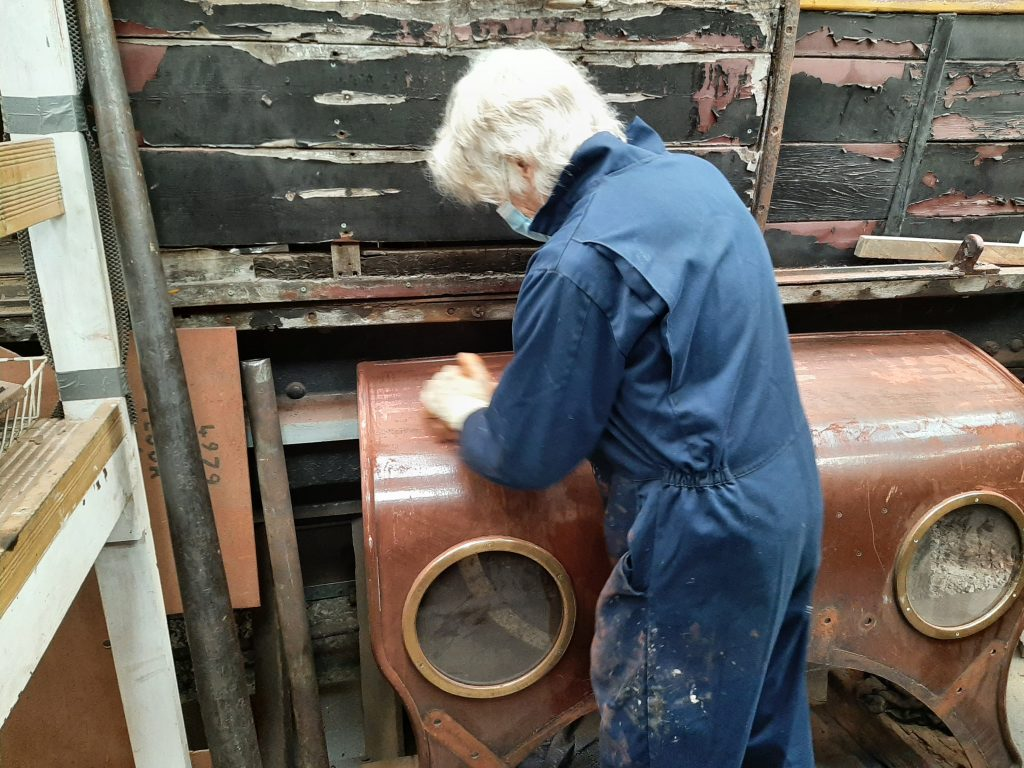 Ed Tatham rubs down FR 20's cab spectacle plate
