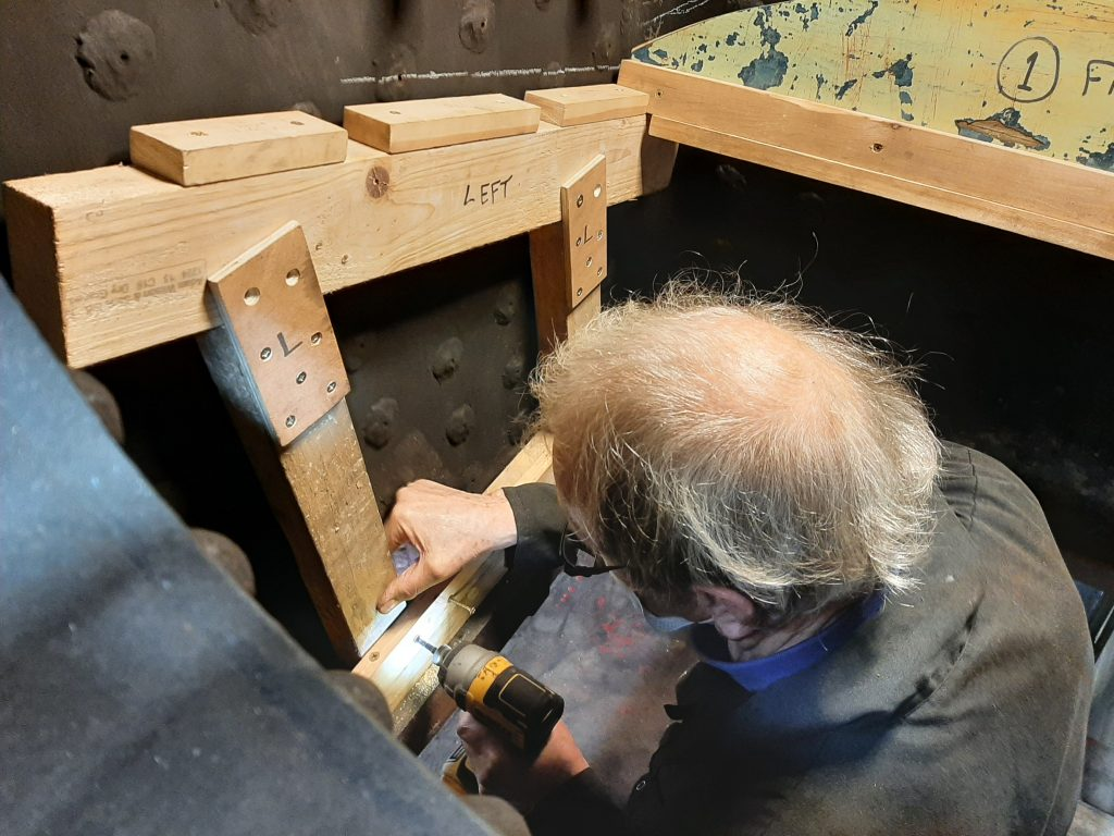 John Dixon constructs the formers for the new brick arch in FR 20