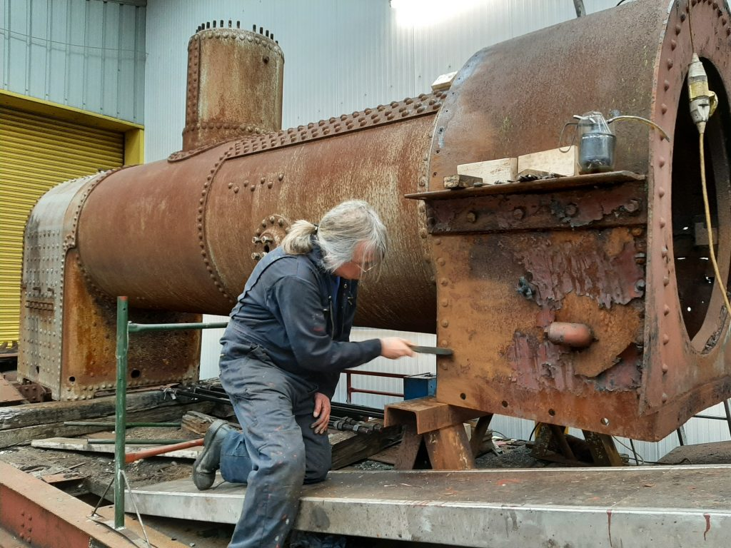 Ade fighting a losing battle with the rust on Caliban's smokebox