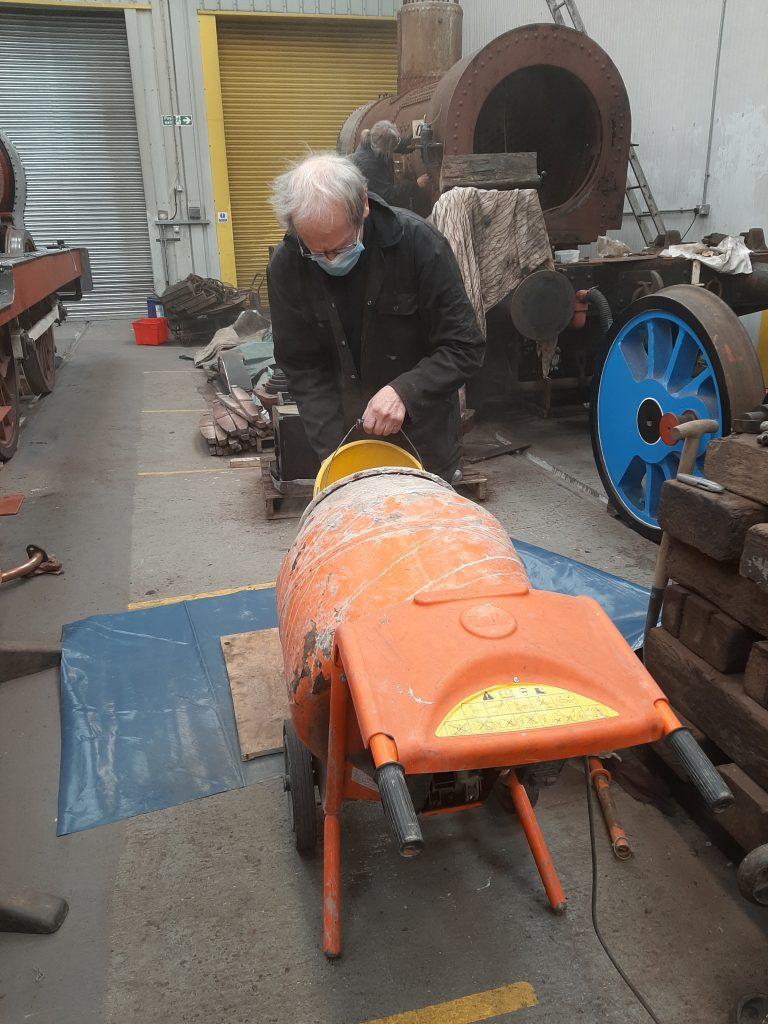John Dixon busy with the concrete mixer