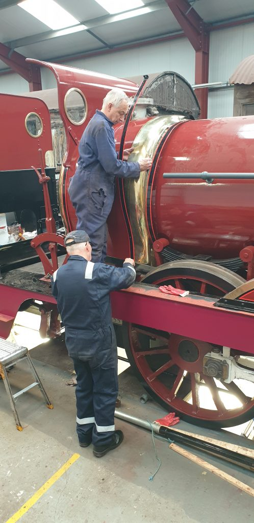 Tim and Ron Crowe fitting the decorative brass work on FR 20
