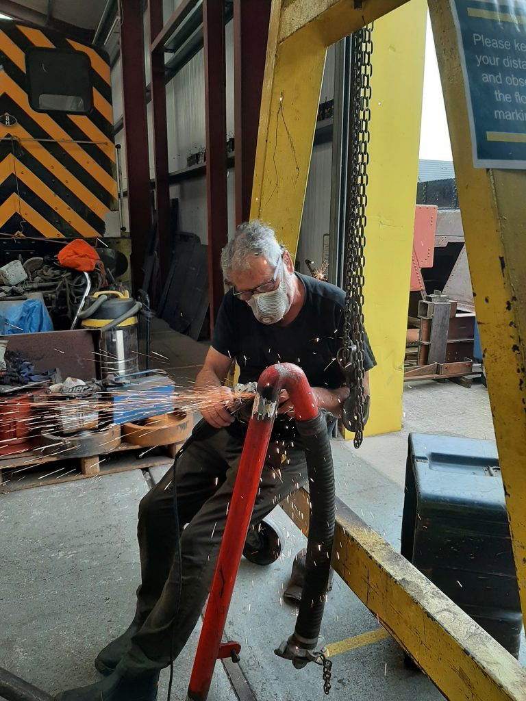 Keith grinding Wootton Hall's repaired tender pipework