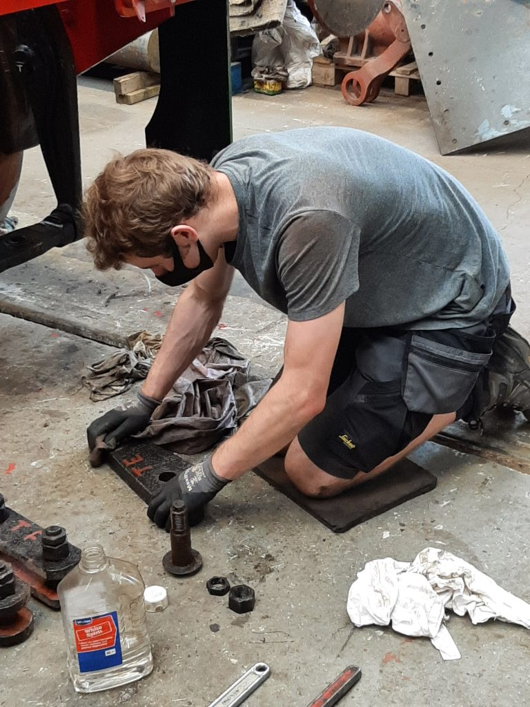 Sam cleaning Wootton Hall's tender brake linkage