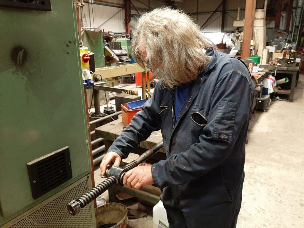 Ade testing the Cumbria's handbrake nut on the shaft
