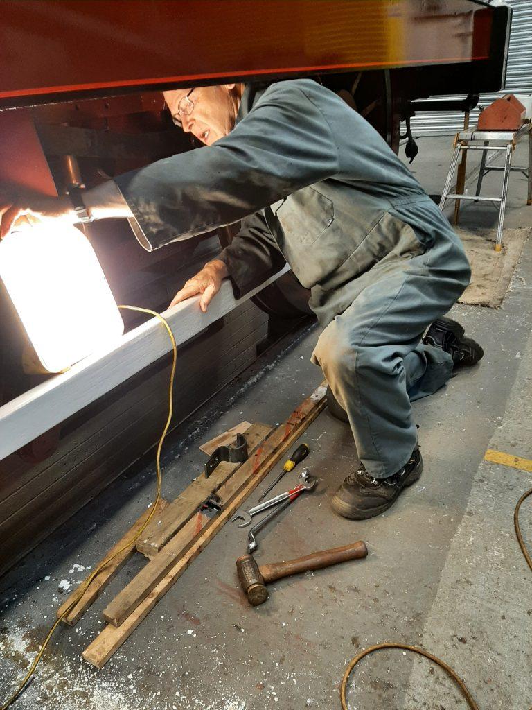 John Dixon working under FR 20's R/H valance.